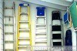 Four garage wall ladders on hooks
