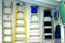 Four garage wall ladders on hooks