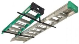 The StoreYourBoard ceiling rack holding two ladders