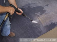 Carpet-like garage floor mats can be pressure washed