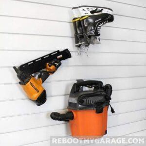 Power tools hanging on the Proslat 13010 hooks