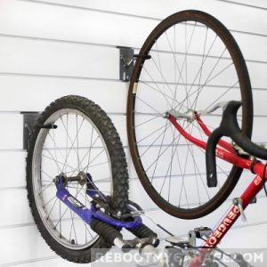 Hang the bike by the front and back tires on the Proslat 13028 Vertical Bike Hooks