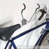 Stalwart bike rack folds back onto the wall