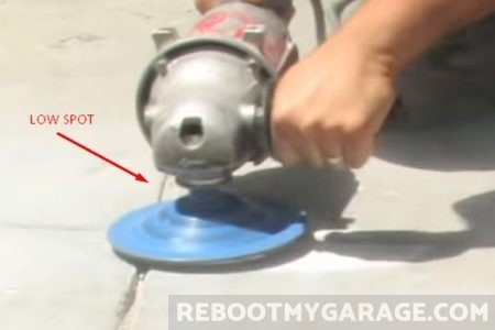 Using an angle grinder on a concrete low spot