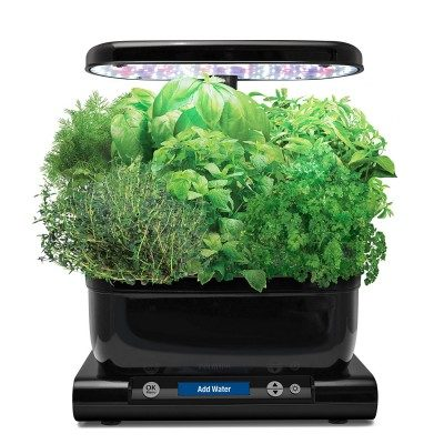 Indoor grow system comes with plant, hardware and light