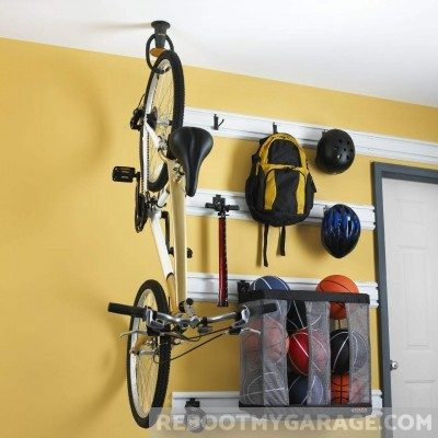 Bike hanging from Bike Claw in Ceiling