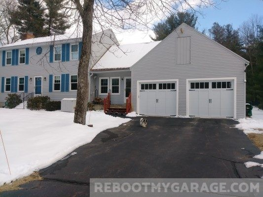 Our home with our new steel garage doors