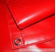 Red tractor tarp with grommet