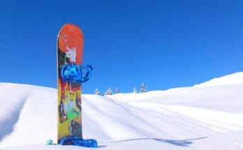 Snowboard in snow
