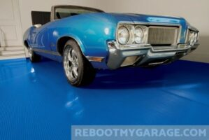 Beautiful blue roll out floor mat and a Buick Skylark