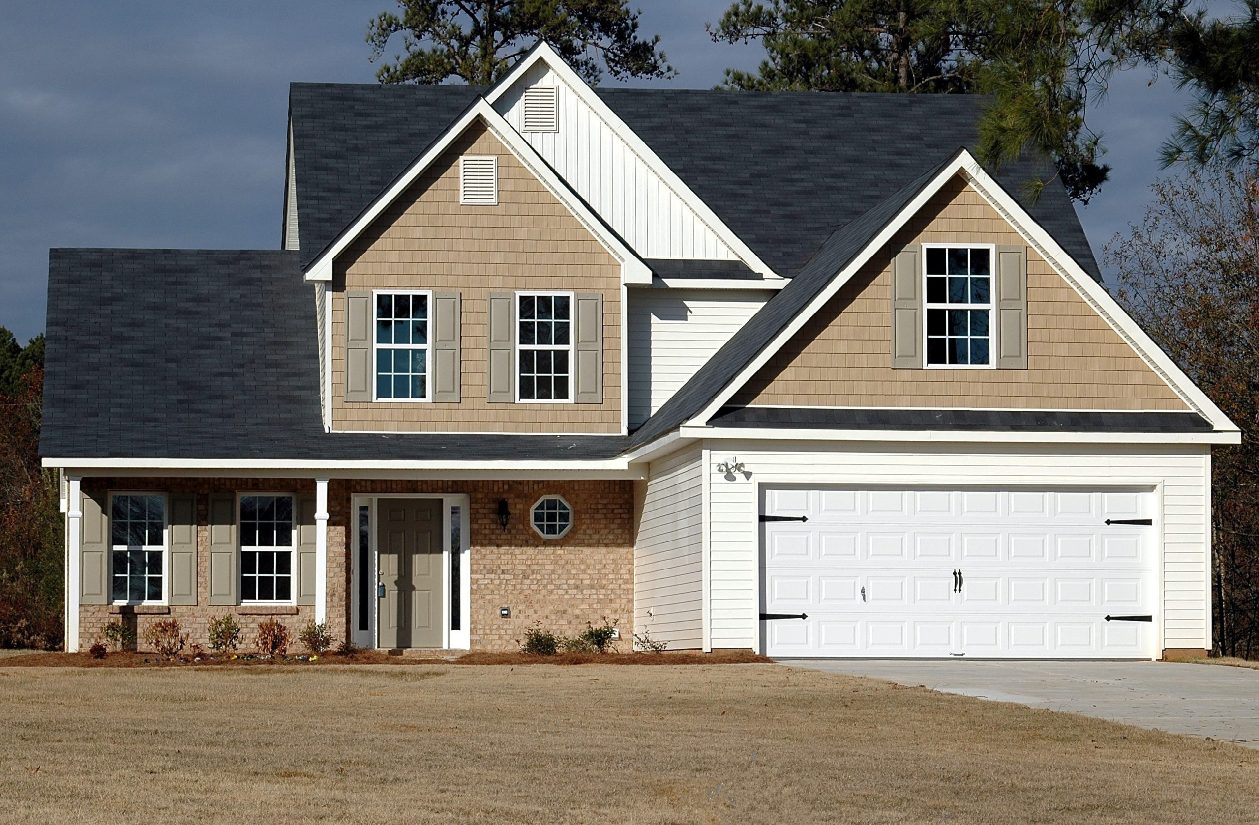 Beautiful white garage door with carriage accent hardware