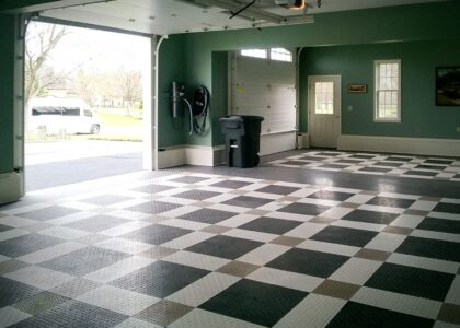 This GarageTrac floor uses black, white and alloy floor tiles