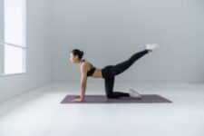 You can add a yoga mat to a hard floor or get a rubber floor or carpet for yoga.