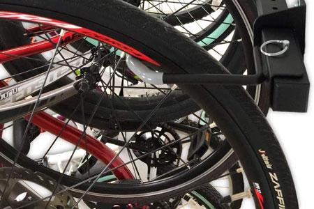 The StoreYourBoard 5-bike rack tires jut under the rack.