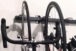 The StoreYourBoard 5-Bike rack allows bike tires to touch the wall, redistributing bicycle weight away from just the rim, saving it from warping.