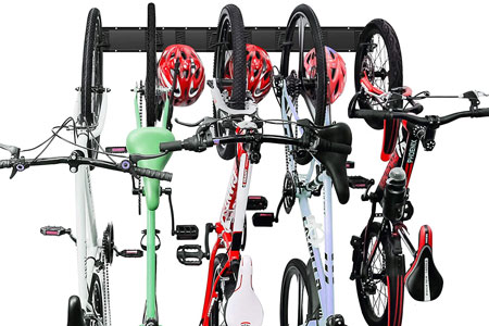 The Wallmaster holds five bikes. Wide handlebars jut into another bike's space.