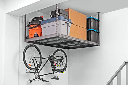 A NewAge VersaRack with bicycle stored underneath