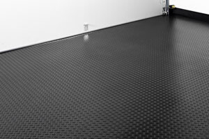 A rollout floor mat can cover the entire garage floor.