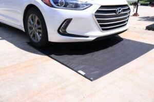 """Called a """"containment mat,"""" this mat is too small to catch snow falling from the sides."""